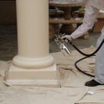 Column being spray painted